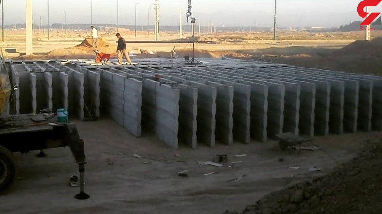 عکس  نصب قبرهای پیش ساخته 4 طبقه در بهشت زهرا